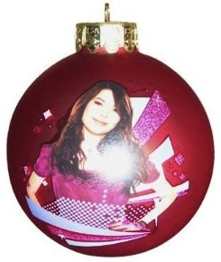 Red glass ball christmas ornament with a picture of Miranda Cosgrove (iCarly)